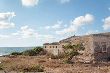 Abandoned building on Atlantic coast of Morocco near Dar Bouazza