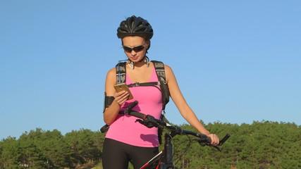 woman cyclist on mountain bike tracks cycling workout