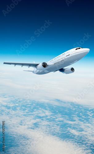 Fotobehang Vliegtuig Airplane and clouds