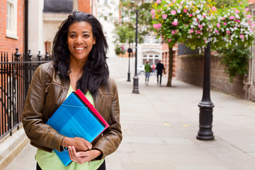 young woman holding folders