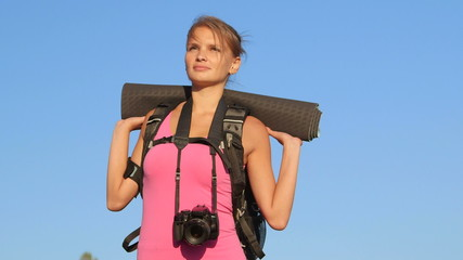 Hiking young woman looking away during hike trekking