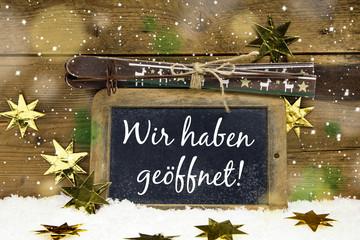 Schild: Wir haben geöffnet an Weihnachten