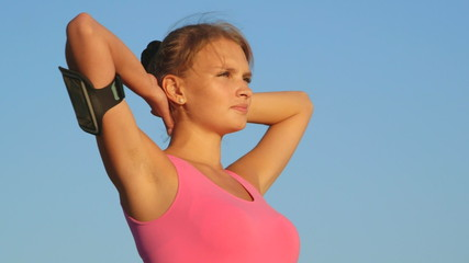 Fitness young woman looking away against sky after exercise