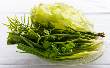 Vegetables such as olive leaf, onion, parsley, lettuce