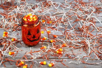 Scary Halloween pumpkin jar filled with candy