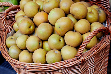 Basket with pears at the market