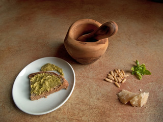 Italian cuisine: pesto genovese with mortar and pestle
