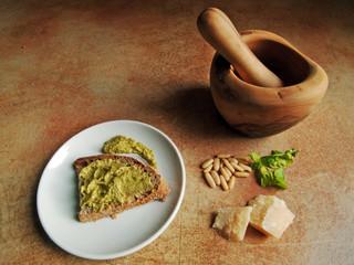 Italian cuisine: pesto genovese with mortar and pestle