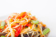 papaya salad on dish with white paper background