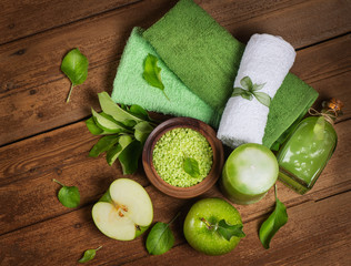 Spa concept with green apples  top view