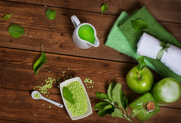 .Spa of green apple on a wooden bord top view