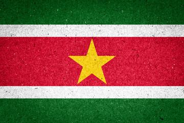 Suriname flag on paper background