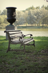 Bench in the park on a background of lake