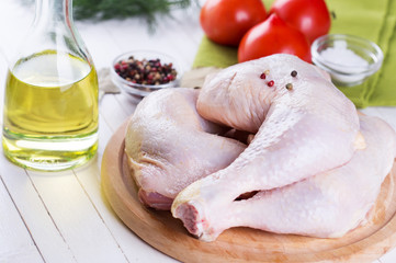 Fresh chicken on wooden table
