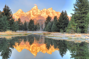 Grand Tetons sunrise over frozen lake - Schwabachers Landing , S