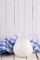 Milk or kefir  on wooden table