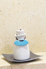 Soap or Shampoo ceramic container with marble background