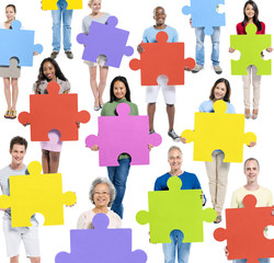 Group of People Holding Colourful Jigsaw