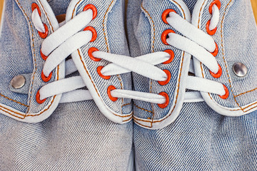Old jeans sports shoes laced unusually