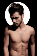 portrait of a naked fit young man with light aura