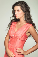 side view of an elegant woman in red dress