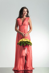 smiling elegant woman in red dress holding a flower basket