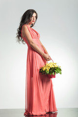 fashion woman in red dress holding a flower basket