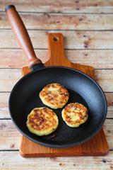 three pancakes in a frying pan
