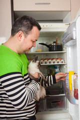 man looking for something for cat