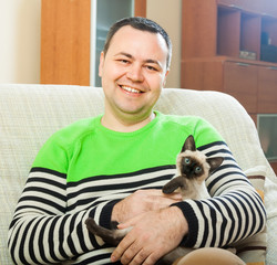 Happy man with  kitten