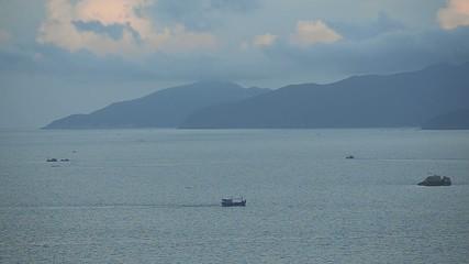 Fishing boat on the beautiful morning sea