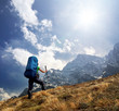 canvas print picture - Tourist in high mountains. Active life concept
