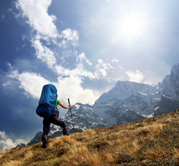 Tourist in high mountains. Active life concept
