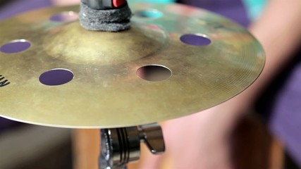 Cymbal in front of drummer playing at cajon