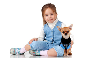 Child lying with a small dog on white background, isolated.