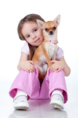 Child sitting with a small dog on white background, isolated.