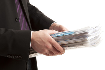 Person holding stack of paper
