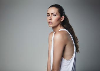 Beautiful young female model posing in tank top