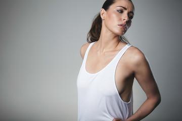 Pretty young female model posing tank top