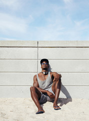 Young african man relaxing on the beach.
