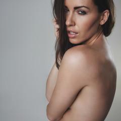 Seductive female model on grey background