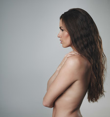 Shirtless woman with curly long hair