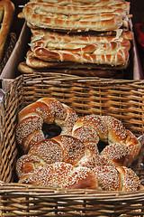 Bagels and bread in wicker baskets