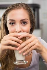 Pretty blonde enjoying a latte