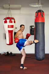 Fighter kicking the punch bag