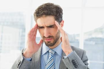 Businessman suffering from a headache