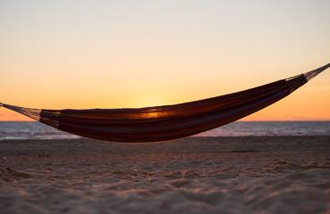 hammock in sunset at beach