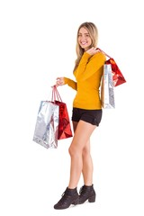 Stylish blonde smiling with shopping bags