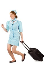 Pretty air hostess pulling suitcase