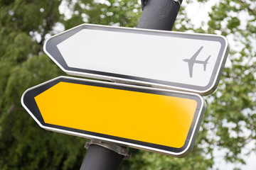 Yellow and white arrow road sign.